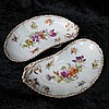 A pair of crescent dishes, prettily hand decorated
