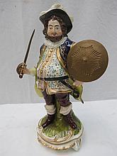A 19thC Derby figure of Falstaff holding a sword