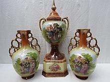 A late 19thC ceramic garniture, the central vase