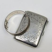An HM silver cigarette case with foliate scroll