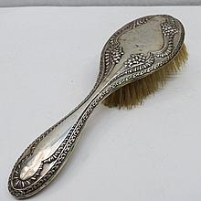 A silver mounted hairbrush, marked Chester, early