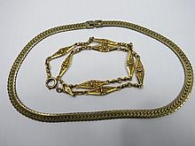 A gold plated flat link necklace by Monet and a