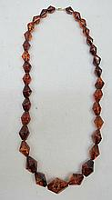 An amber necklace of graduated irregular conical