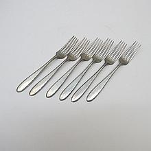 Six white metal dessert forks marked Sterling and
