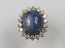A star sapphire and diamond cluster ring, the