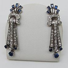 A pair of art deco style sapphire and diamond drop stud earrings