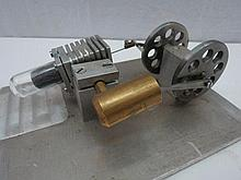 A scale model live steam hot air single cylinder