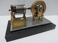 A scale model live steam heat exchange stationary