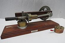 A scale model live steam hot air engine flywheel