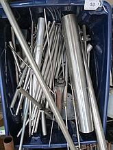 A box containing a quantity of metal rods and