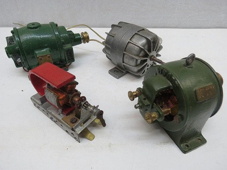 Four scale model dynamos.