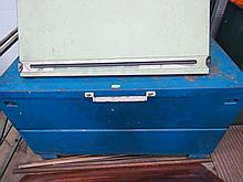 A large metal tool chest.