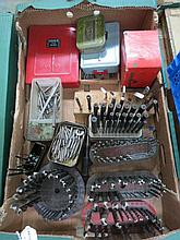 A box containing a quantity of drill bits.