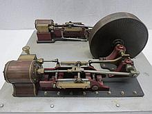 A scale model live steam stationary twin piston