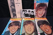 Beatles picture books for all four, together with