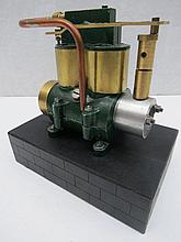 A scale model live steam twin piston stationary