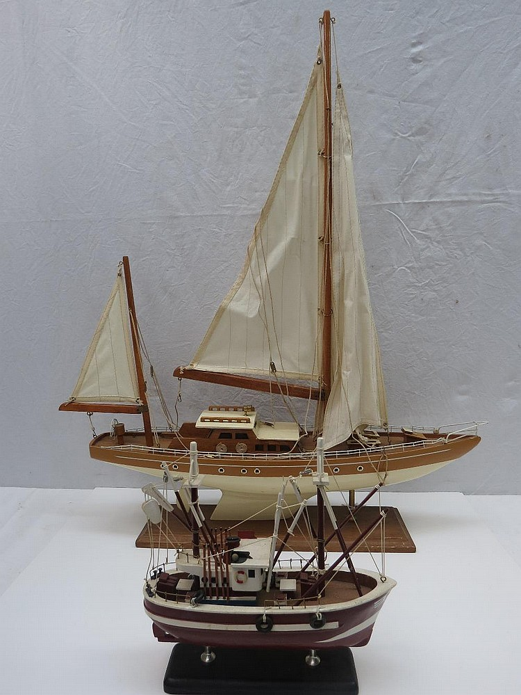 A late 20thC model yacht with cream hull and another boat