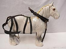 A Beswick grey shire horse with harness, 22cm