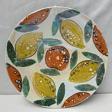 An Anita Harris studio pottery charger decorated