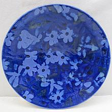 An Anita Harris studio pottery charger with blue