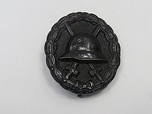 A WWII German wound badge, of pressed metal with