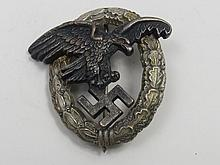 A Nazi Observers badge, eagle and swastika within
