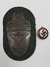 A Nazi Demjansk shield with an aircraft and