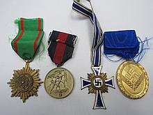 Four assorted Nazi medals with ribbons including a