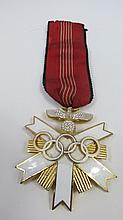 A German Olympic decoration, white enamelled gilt
