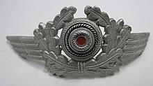 A WWII German Luftwaffe Officer's cap insignia.