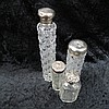 An HM silver topped cut glass bottle from a