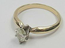 A single marquise diamond ring claw set in white