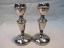 A pair of HM silver miniature candlesticks of