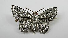 A diamond set butterfly brooch, body and wings set
