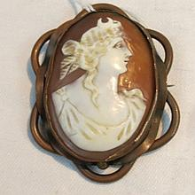 A Victorian shell cameo in base metal mount.