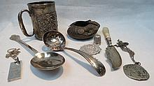An HM silver serving spoon of trifoid design with