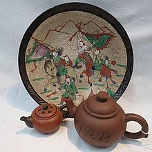 A Chinese decorated plate, decorated with scenes