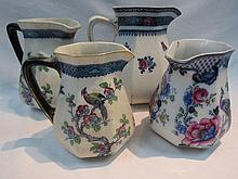 Four graduated Losol ware jugs in slightly varying