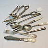 A pair of silver plated grape scissors, mother of