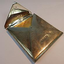 A silver cigarette case in the shape of an