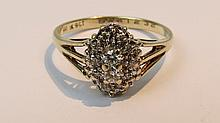 A diamond cluster ring, two brilliants set