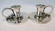 A pair of Georg Jensen chambersticks, import mark