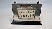 An HM silver desk calendar (patent no. 9954) on
