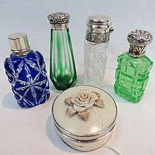 Four silver mounted cut glass scent bottles in