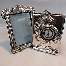 An HM silver Art Nouveau picture frame with velvet