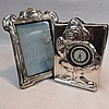 An HM silver Art Nouveau picture frame with velvet