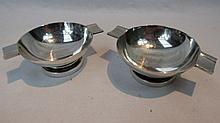 A pair of Georg Jensen ashtrays, of plain shallow