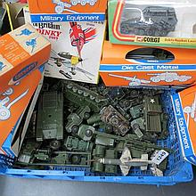 A quantity of boxed and loose military vehicles