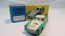 A Corgi Aston Martin DB4, finished in turquoise