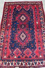 An Afsha rug, red ground with blue and cream